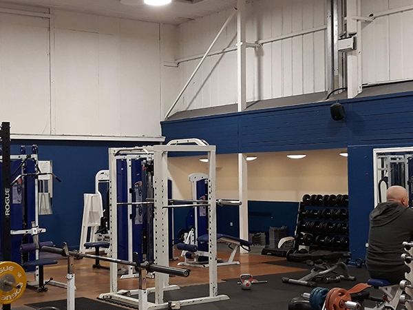 Speaker PA Sound System with Black Speakers in Weight Lifting Gym