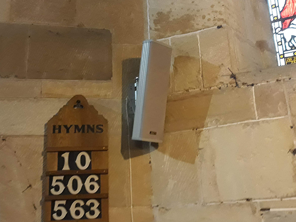 White loudspeaker wallmount brack av installation to church houses of worship