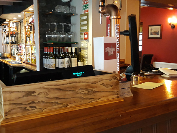 the bar of the pub with speaker system installation