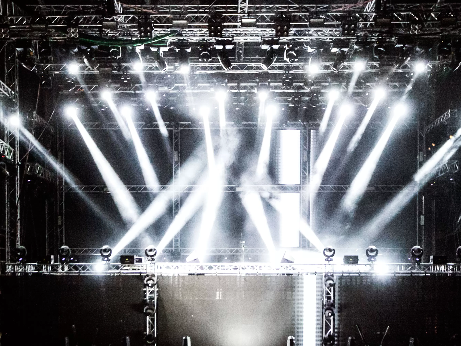 Lots of stage lights installed on an empty stage ready for a performance from a musician