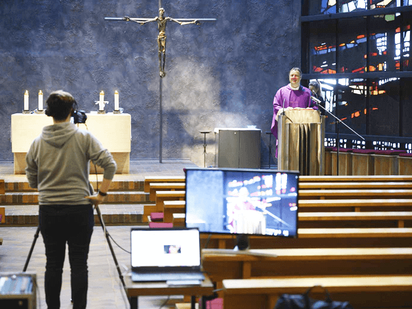 A church service being streamed live through video conferencing audio visual installations