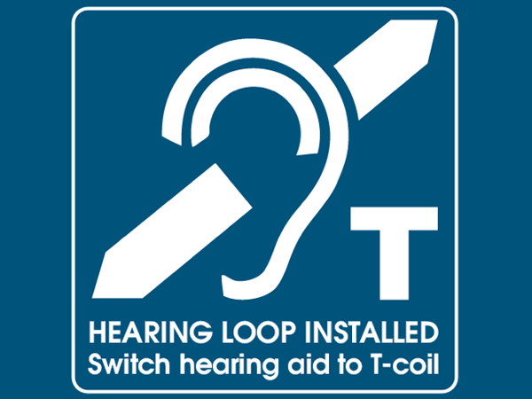 A sign for the hard of hearing that indicates the church has been installed with a hearing loop induction system