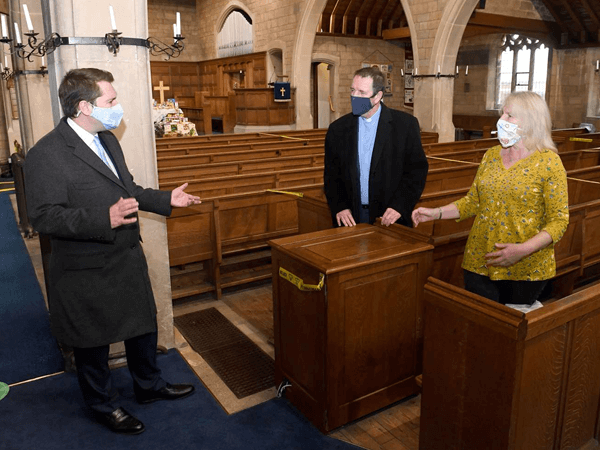 An audio visual installation expert visiting a church to quote for a sound system