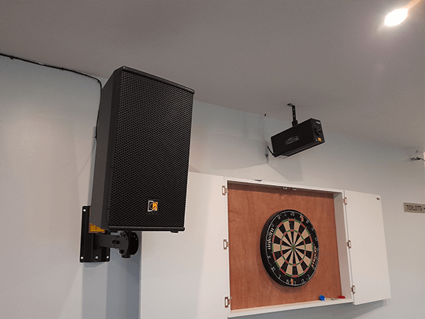 Black Wall mounted Speaker on Bracket installed in a cricket sports club